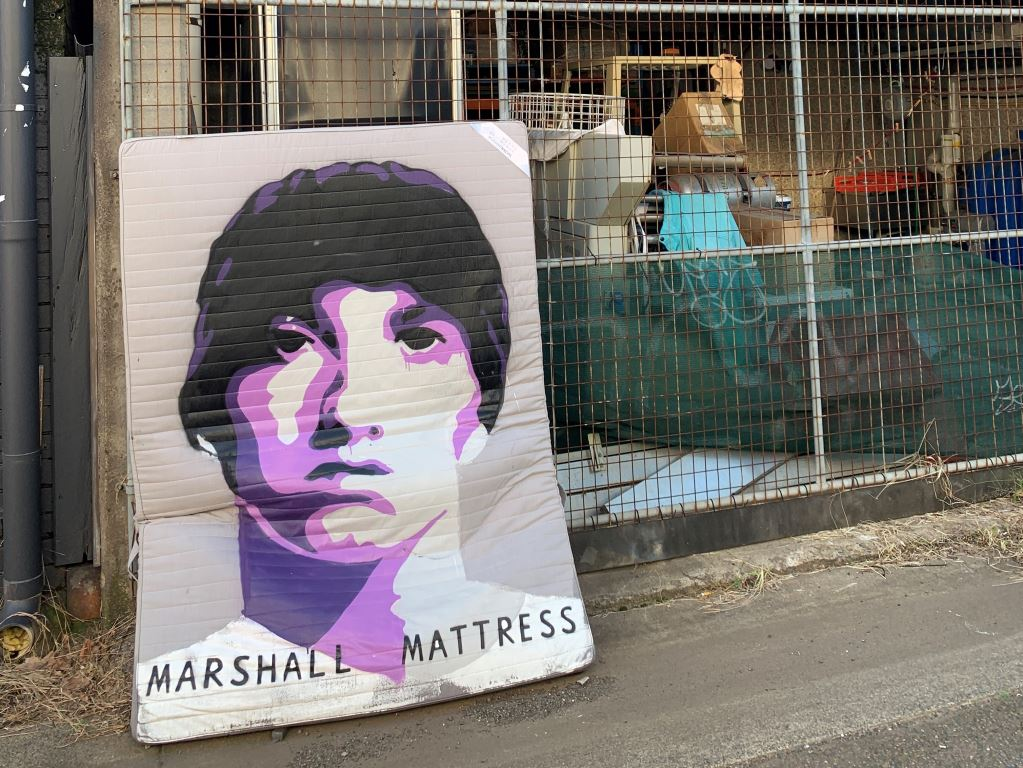 mural of marshall mathers painted on a matress and named Marshall Matrress