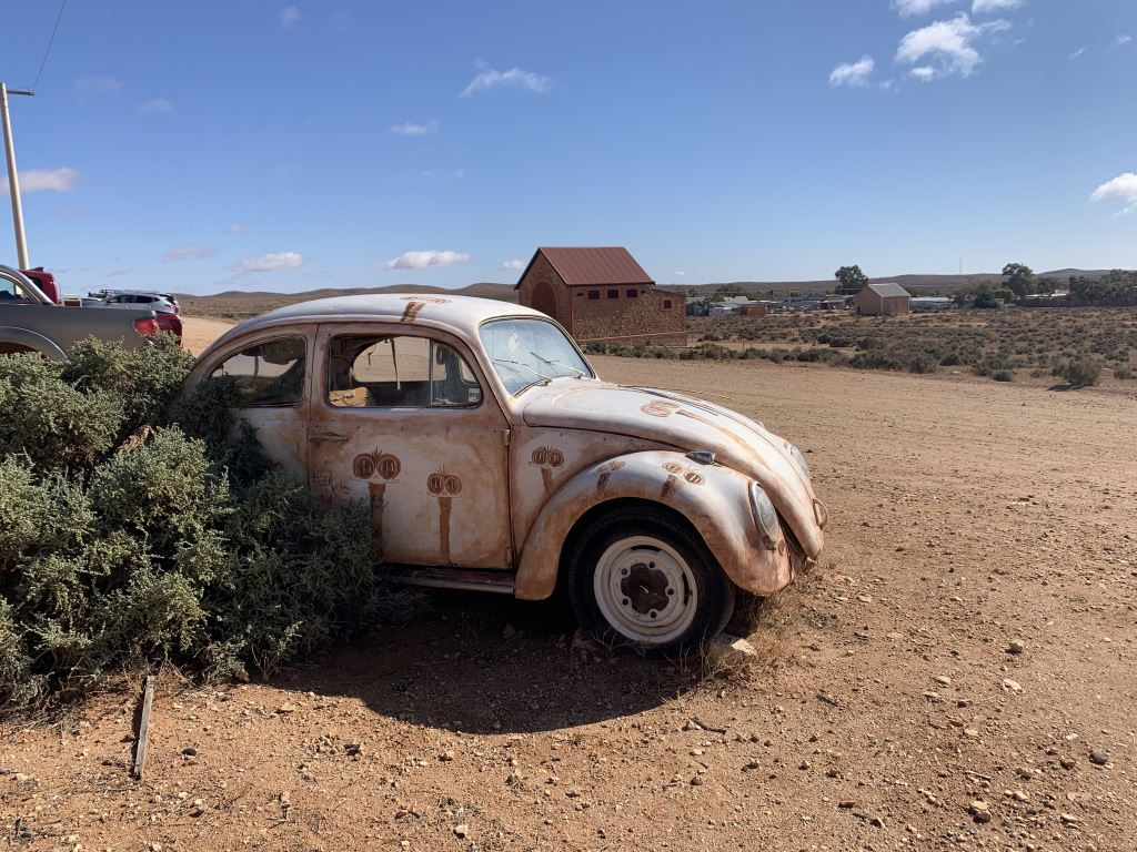 old Volkswagen bug painted with a rusty colour paint