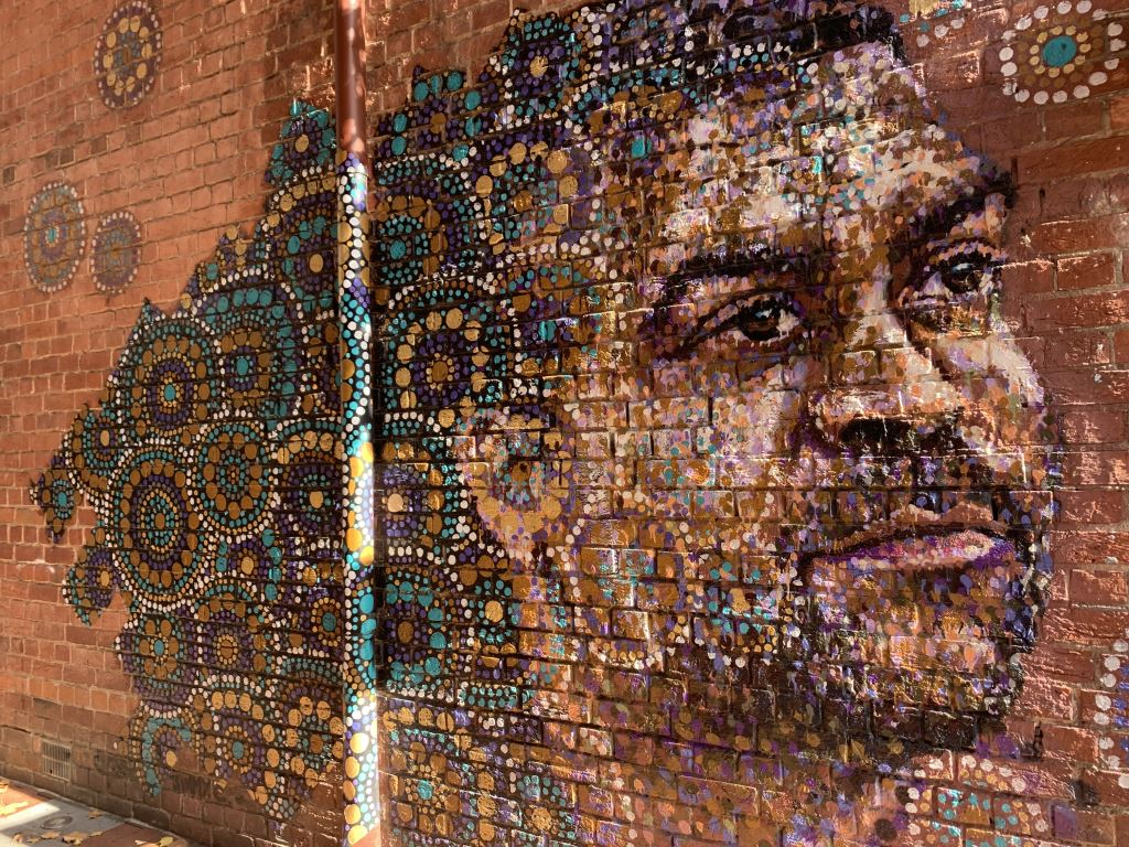 mural of a face by artist jimmy c