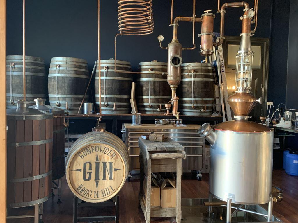 inside the broken hill distillery showing the still and barrels of gin