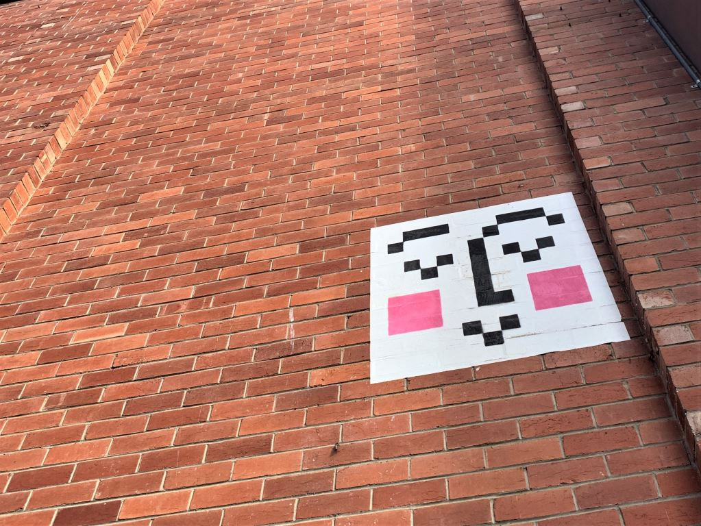 image of a smiley made from pixels on a wall in Adelaide